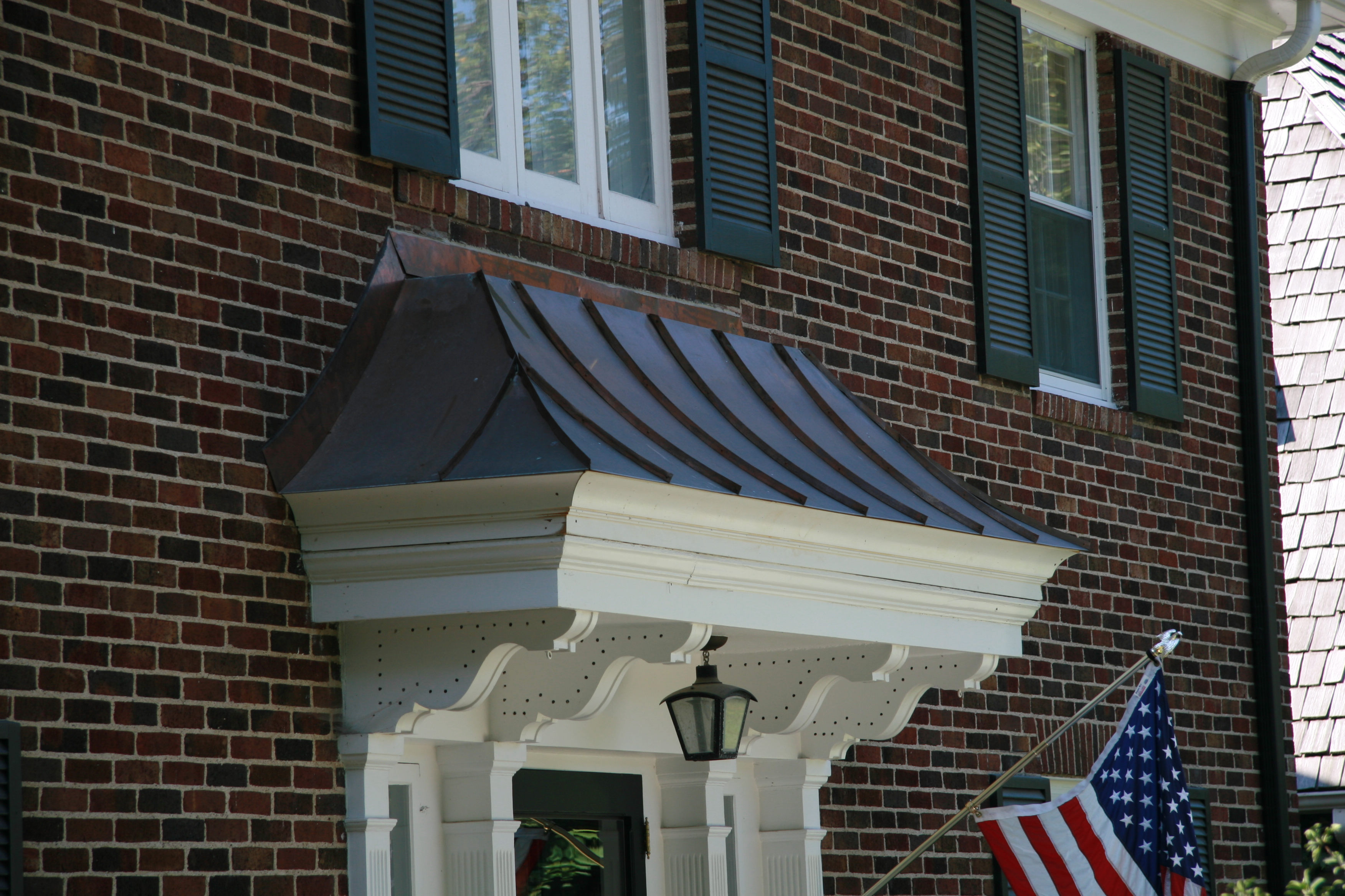 Copper window bay roofs installed for Bay window installation