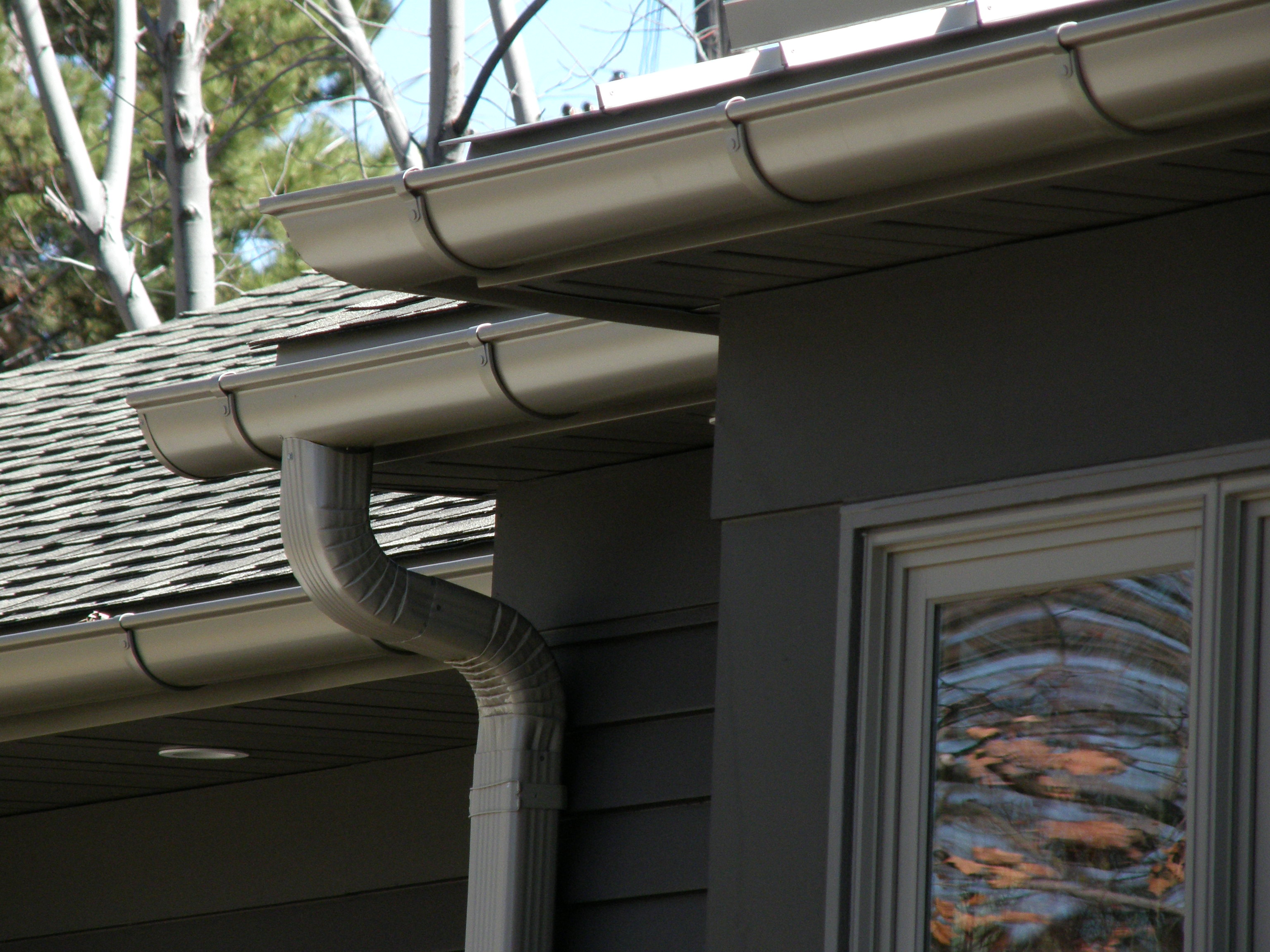 Mpls half round gutter installation for Painting aluminum gutters